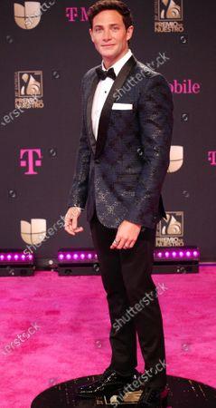 Gabriel Coronel walks the red carpet at the 33 edition of Univision 2021 Premio Lo Nuestro award show