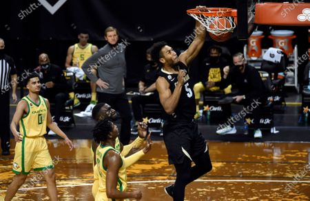 Colorado guard D'Shawn Schwartz (5) dunks as Oregon guard Will Richardson (0), center Franck Kepnang (22) and Oregon forward Chandler Lawson (13) trail during the first half of an NCAA college basketball game, in Eugene, Ore
