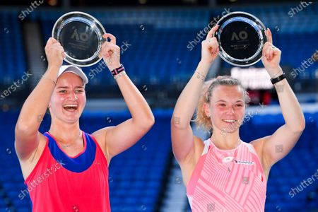Barbora Krejcikova (L) of the Czech Republic and Katerina Siniakova of the Czech Republic pose for photographs with the runner up trophy after losing their Women's Doubles Finals match against Elise Mertens of Belgium and Aryna Sabalenka of Belarus on Day 12 of the Australian Open Grand Slam tennis tournament at Melbourne Park in Melbourne, Australia, 19 February 2021.