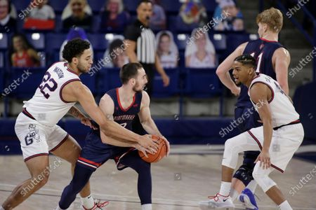 Gonzaga forward Anton Watson, left, and guard Aaron Cook double team Saint Mary's guard Tommy Kuhse during the first half of an NCAA college basketball game in Spokane, Wash