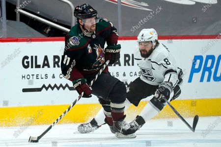 Arizona Coyotes right wing Phil Kessel (81) skates with the puck against Los Angeles Kings defenseman Drew Doughty (8) during the second period of an NHL hockey game, in Glendale, Ariz