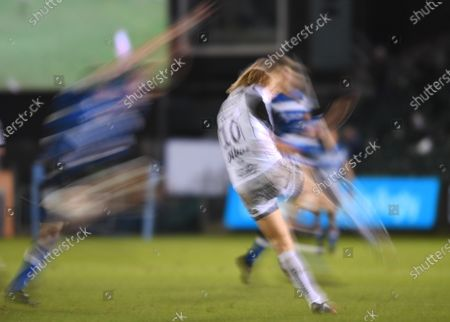 Stock Photo of Billy Twelvetrees of Gloucester kicks under pressure from Mike Williams of Bath; Recreation Ground, Bath, Somerset, England; English Premiership Rugby, Bath versus Gloucester.