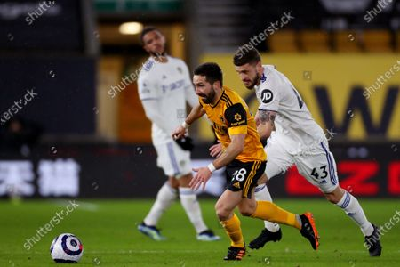 Stock Picture of Joao Moutinho of Wolverhampton Wanderers and Mateusz Klich of Leeds United
