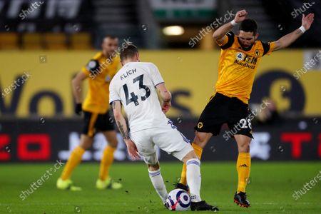 Stock Image of Mateusz Klich of Leeds United and Joao Moutinho of Wolverhampton Wanderers