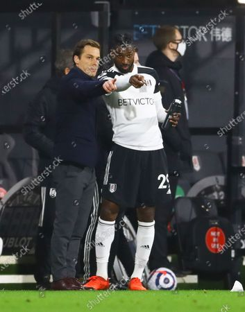 Fulham manager Scott Parker issues instructions to Andre Frank Zambo Anguissa
