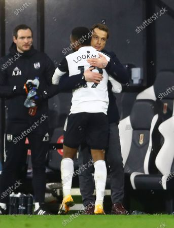 Fulham manager Scott Parker hugs Ademola Lookman after substituting him