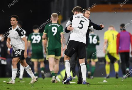 Fulham manager Scott Parker hugs Joachim Andersen at full time