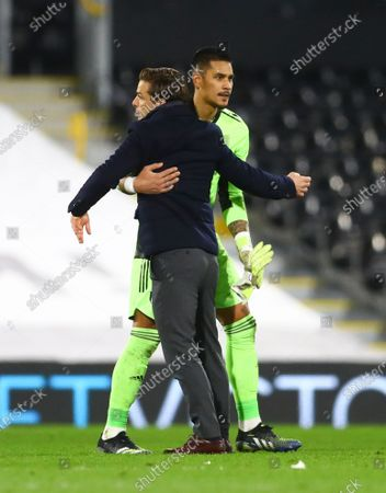 Fulham manager Scott Parker celebrates with Fulham goalkeeper Alphonse Areola