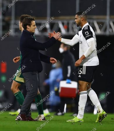 Fulham manager Scott Parker shakes hands with Ruben Loftus-Cheek of Fulham at full time