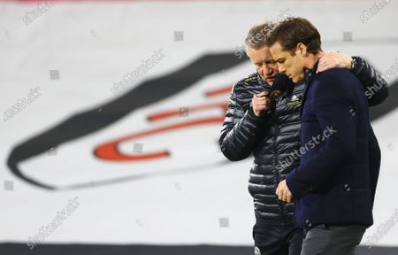 Stock Photo of Sheffield United Manager Chris Wilder hugs Fulham manager Scott Parker ahead of the warm up