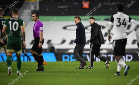 Fulham manager Scott Parker and Fulham Assistant Manager Matt Wells walk off at half time