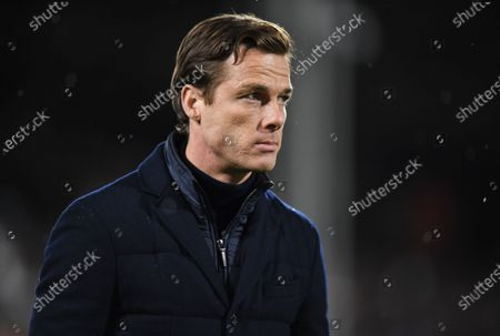 Fulham manager Scott Parker watches the warm up