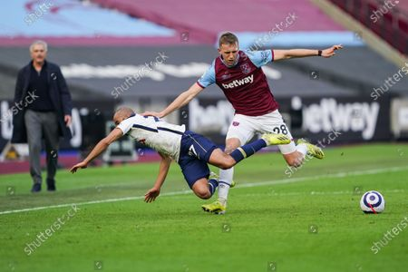 Tomas Soucek of West Ham United wins the ball off Lucas Moura of Tottenham Hotspur