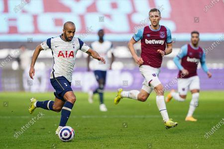 Lucas Moura of Tottenham Hotspur runs the ball