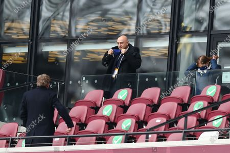 Daniel Levy Chair of Tottenham Hotspur puts on his mask as he takes his seat in the West Ham United Director's Box to watch the match