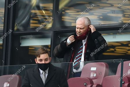 David Gold Chairmen of West Ham United adjusts his mask as he takes his seat in the Director's Box