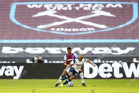 Ben Johnson of West Ham United challenges Lucas Moura of Tottenham Hotspur