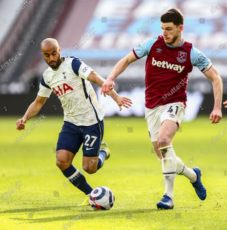 Declan Rice of West Ham United is challenged by Lucas Moura of Tottenham Hotspur