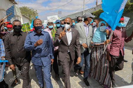 Former Prime Minister of Somalia Hassan Ali Khaire (C) joins members of opposition parties as they protest against the political impasse, in the streets of Mogadishu, Somalia, 19 February 2021. Somalia is in the midst of a political impasse between the central government and federal states seeking an agreement over elections and the president's mandate which expired 08 February 2021. Somalia's presidential elections were meant to have taken place before President Mohamed Abdullahi Farmaajo's four-year term expired.