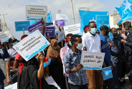 Supporters of opposition parties protest against the political impasse in the streets of Mogadishu, Somalia, 19 February 2021. Somalia is in the midst of a political impasse between the central government and federal states seeking an agreement over elections and the president's mandate which expired 08 February 2021. Somalia's presidential elections were meant to have taken place before President Mohamed Abdullahi Farmaajo's four-year term expired.