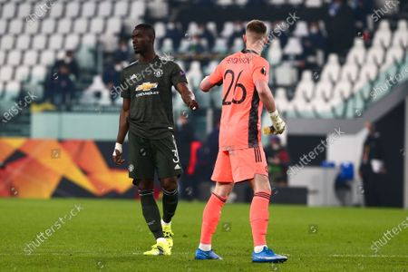 Eric Bailly and Dean Henderson of Manchester Utd. FC  during the first leg of round of 32 of UEFA Europa League between Real Sociedad and Manchester United FC at Juventus Stadium on February 18, 2021 in Turin, Italy.Real Sociedad lost 0-4 over Manchester United. (Photo by Massimiliano Ferraro/NurPhoto)