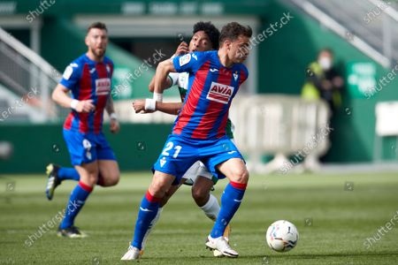 Johan Mojica  of Elche C.F duels for the ball with Pedro Leon Sanchez of SD Eibar during the La Liga match between Elcche CF and SD Eibar at Martinez Valero stadium on February 20, 2021 in Elche, Spain.