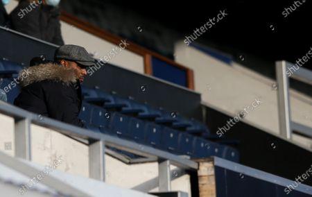 Stock Picture of Les Ferdinand - QPR Director of Football  wearing a flat cap & a Parka Jacket