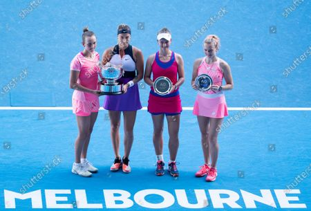 Winners Belgium's Elise Mertens(1st L)/Belarus' Aryna Sabalenka (2nd L) and second placed Barbora Krejcikova (2nd R) and Katerina Siniakova of the Czech Republic pose for photos with their trophies after their women's doubles final at Australian Open in Melbourne Park in Melbourne, Australia, Feb. 19, 2021.