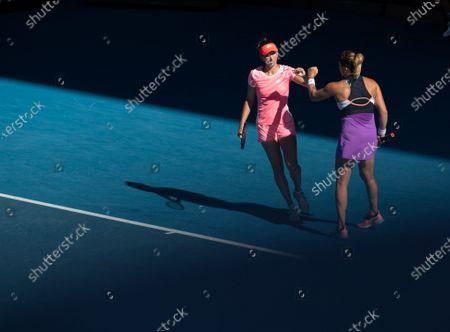 Belgium's Elise Mertens(L)/Belarus' Aryna Sabalenka compete during the women's doubles final between Belgium's Elise Mertens/Belarus' Aryna Sabalenka and Barbora Krejcikova/Katerina Siniakova of the Czech Republic at Australian Open in Melbourne Park in Melbourne, Australia, Feb. 19, 2021.