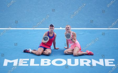 Second placed Barbora Krejcikova (L) and Katerina Siniakova of the Czech Republic pose with their trophies after the women's doubles final between Belgium's Elise Mertens/Belarus' Aryna Sabalenka and Barbora Krejcikova/Katerina Siniakova of the Czech Republic at Australian Open in Melbourne Park in Melbourne, Australia, Feb. 19, 2021.