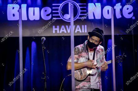 Stock Photo of Jake Shimabukuro performs at The Blue Note Hawaii at The Outrigger Waikiki Resort in Honolulu