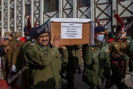 Stock Picture of Indian police officers carry the coffin of their colleague Mohammad Yousuf during a wreath laying ceremony in Srinagar, Indian controlled Kashmir, . Anti-India rebels in Indian-controlled Kashmir killed two police officers in an attack Friday in the disputed region's main city, officials said. Elsewhere in the Himalayan region, three suspected rebels and a policeman were killed in two gunbattles