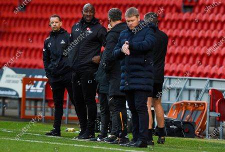 Manager Darren Moore of Doncaster Rovers and Manager Grant McCann of Hull City