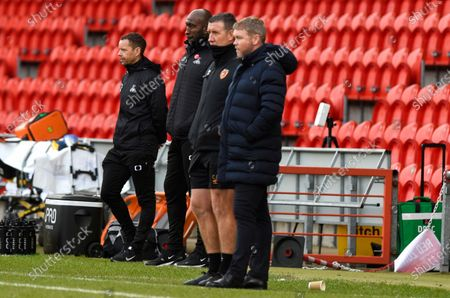 Manager Darren Moore of Doncaster Rovers with Manager Grant McCann of Hull City and Assistant Manager Cliff Byrne