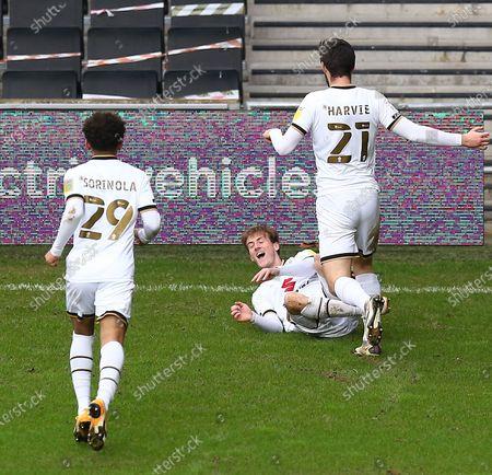 Charlie Brown of Milton Keynes Dons celebrates scoring his sides fourth goal