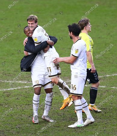 Stock Image of Charlie Brown of Milton Keynes Dons celebrates with team-mates  after the match