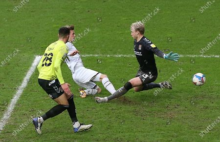 Charlie Brown of Milton Keynes Dons scores his sides fourth goal