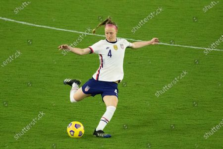Becky Sauerbrunn (#4 United States) clears the ball from midfield