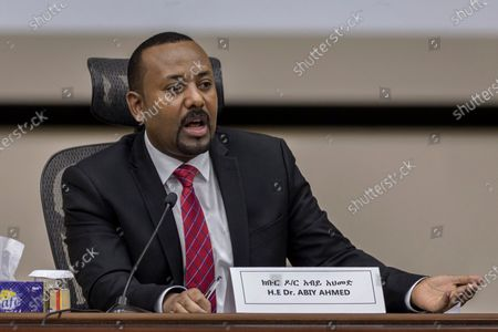 """Ethiopia's Prime Minister Abiy Ahmed responds to questions from members of parliament at the prime minister's office in the capital Addis Ababa, Ethiopia. The U.S. said Friday, Feb. 19, 2021 it has decided to """"de-link"""" its suspension of millions of dollars of aid to Ethiopia from that country's dispute with Egypt over a massive hydroelectric dam but that does not mean all the roughly $272 million in security and development assistance will immediately start to flow, and it depends on more recent """"developments"""" - an apparent reference to the deadly conflict in Ethiopia's Tigray region"""