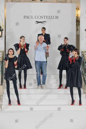 Stock Image of Models with fashion designer, Paul Costelloe