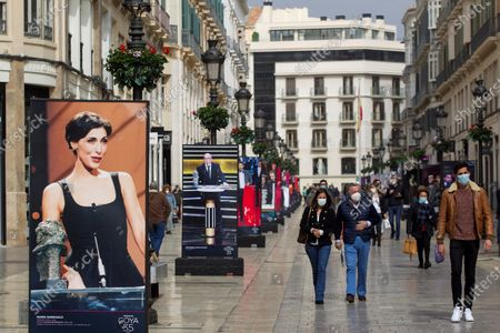A poster showing Spanish actress Maria Barranco receiving a Goya Award is on display at Larios street as part of the exhibition 'Andalusia and the Goya' in Malaga, Spain, 19 February 2021. The exhibition is organized by the Spanish Film Academy and the Andalusian Film Academy on the occasion of the Goya Film Awards gala that will be held on 06 March 2021 and features 58 photographs of Andalusian filmmakers and actors honored with a Goya Award.