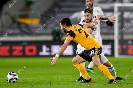 Leeds United midfielder Mateusz Klich (43) and Wolverhampton Wanderers midfielder Joao Moutinho (28) during the Premier League match between Wolverhampton Wanderers and Leeds United at Molineux, Wolverhampton