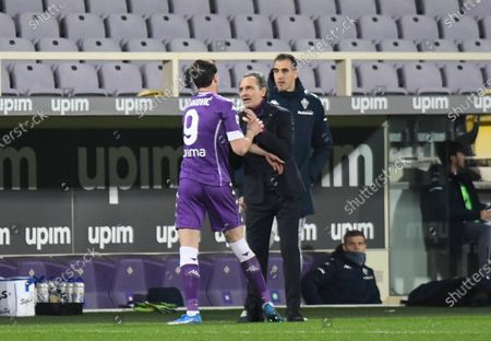 Fiorentina's forward Dusan Vlahovic (L) celebrates with head coach Cesare Prandelli after scoring the 1-0 goal during the Italian Serie A soccer match between ACF Fiorentina and Spezia Calcio at the Artemio Franchi stadium in Florence, Italy, 19 February 2021.