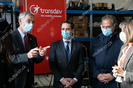 Stock Image of Thierry Mallet CEO of the Transdev group, Jean-Baptiste Djebbari, Minister of Transport and Luc Chatel Pdt of the Automotive platform. Jean-Baptiste Djebbari, Minister of Transport visits MobiLAB, where the Autonomous Transport Systems team of the Transdev group, and the VEDECOM Institute for Energy Transition are located.