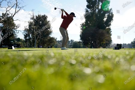 Adam Scott, of Australia, tees off on the 15th hole during the second round of the Genesis Invitational golf tournament at Riviera Country Club, in the Pacific Palisades area of Los Angeles