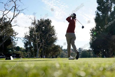 Stock Picture of Adam Scott, of Australia, tees off on the 15th hole during the second round of the Genesis Invitational golf tournament at Riviera Country Club, in the Pacific Palisades area of Los Angeles