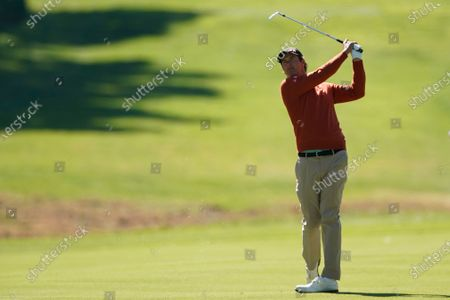 Stock Image of Adam Scott, of Australia, watches his second shot on the seventh hole during the second round of the Genesis Invitational golf tournament at Riviera Country Club, in the Pacific Palisades area of Los Angeles