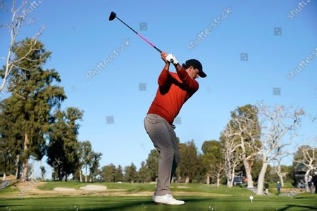 Adam Scott, of Australia, tees off on the 17th hole during the second round of the Genesis Invitational golf tournament at Riviera Country Club, in the Pacific Palisades area of Los Angeles