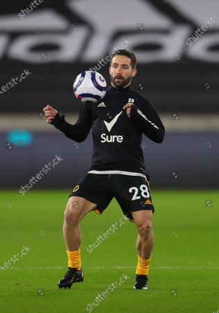 Wolverhampton's Joao Moutinho warms up for the English Premier League soccer match between Wolverhampton Wanderers and Leeds United in Wolverhampton, Britain, 19 February 2021.
