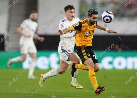 Leeds' Jamie Shackleton (L) in action against Wolverhampton's Joao Moutinho (R) during the English Premier League soccer match between Wolverhampton Wanderers and Leeds United in Wolverhampton, Britain, 19 February 2021.